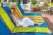Amsterdam-Manor-Beach-Resort-guest-at-pool-lounger