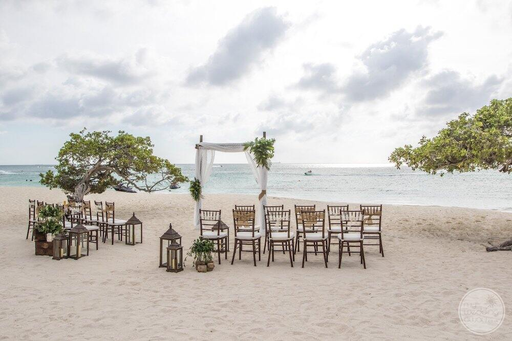 Ceremony set up with chairs on the Santa beside the ocean