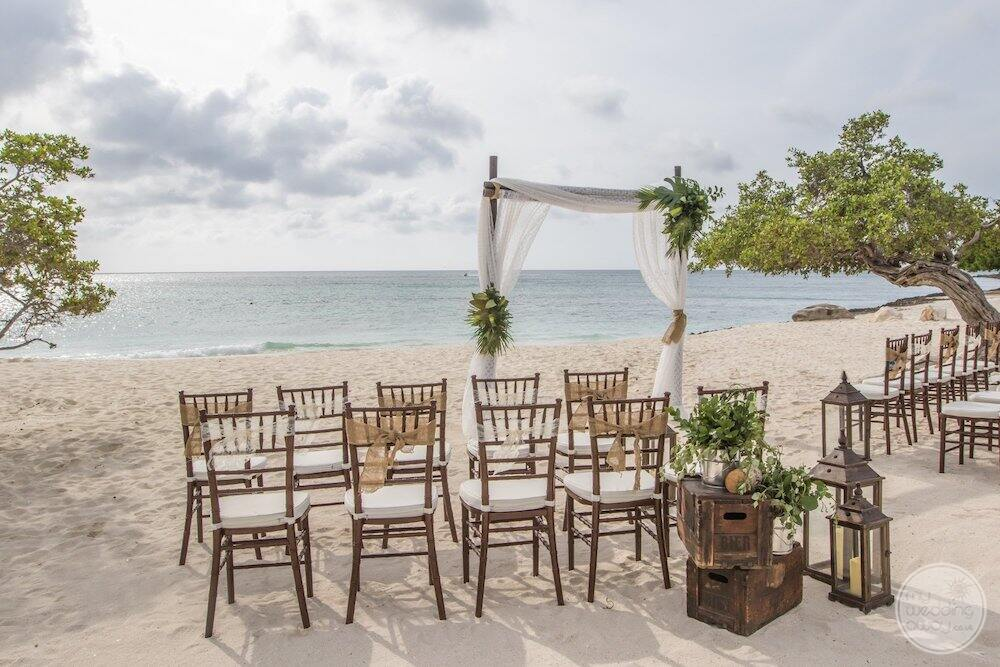 Ceremony set up for wedding with chairs and floral decor