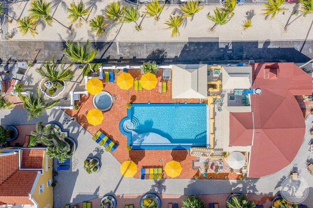 Aerial view of pool and surrounding room buildings