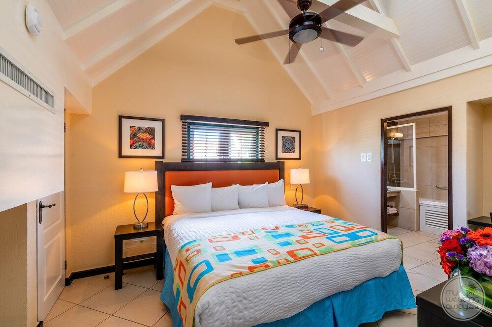 two bedroom suite with king bed and bathroom