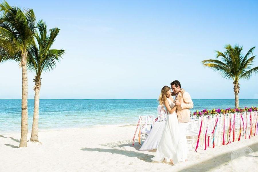 Wedding couple on the beach before wedding reception