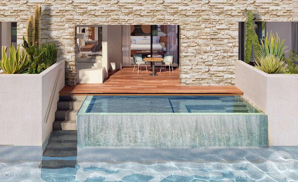 Junior swim out suite with outdoor deck chairs hot tub and Jacuzzi