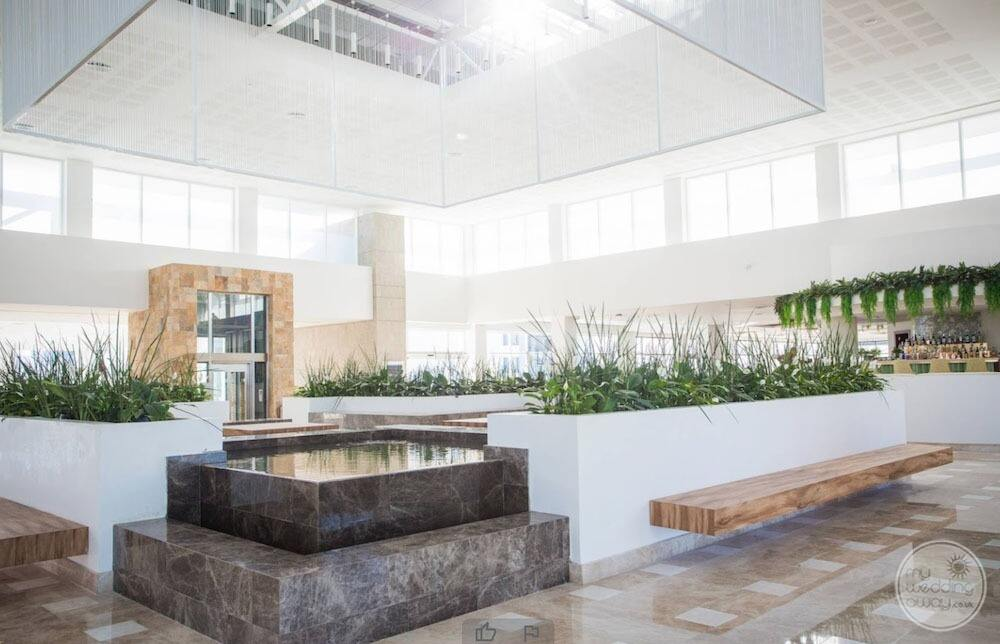 Lobby area with marble and water features
