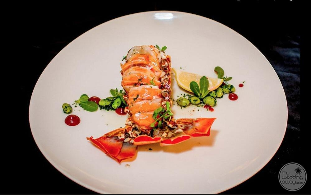 Plate of seafood with lobster and lemon
