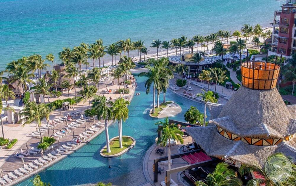Aerial view of main pool swim up bar lounge area and beachfront