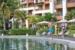 Villa-Del-Palmar-Playa-Mujeres-couple-walking-at-pool