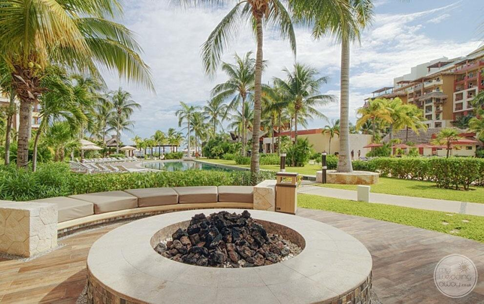 Walkaway pool palm trees lounge area outdoors with fire pit