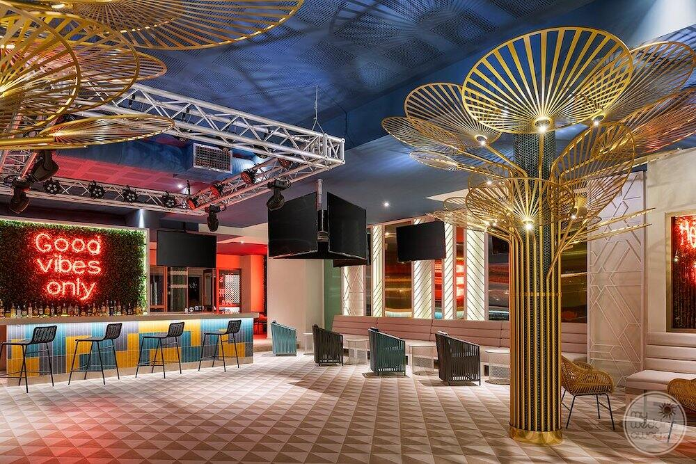 Evening disco good vibes only bar and golden structures on the dancefloor