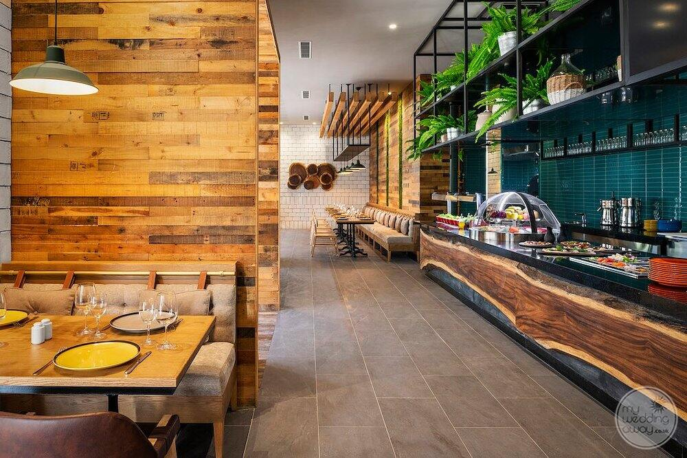 Specialty vegetarian restaurant with a beautiful wood wall decor and buffet food