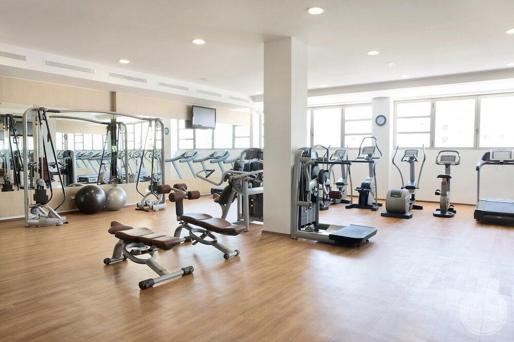 Fitness centre with Weight machines wait balls and exercise equipment
