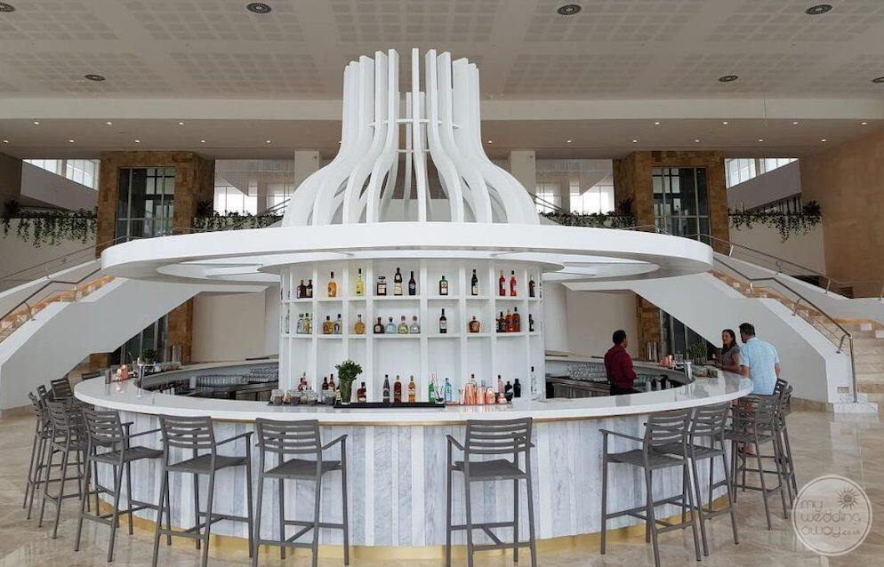 Do you have the lobby bar at with the couple ordering drinks with staircase in the background
