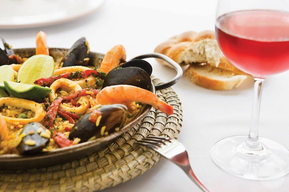 Mediterranean restaurant with a glass of wine and seafood