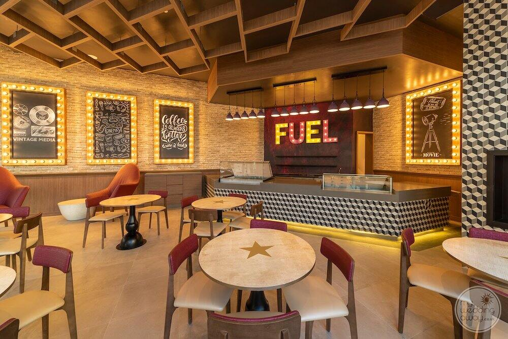 Fuel coffee bar with pastries coffee is and tables and chairs