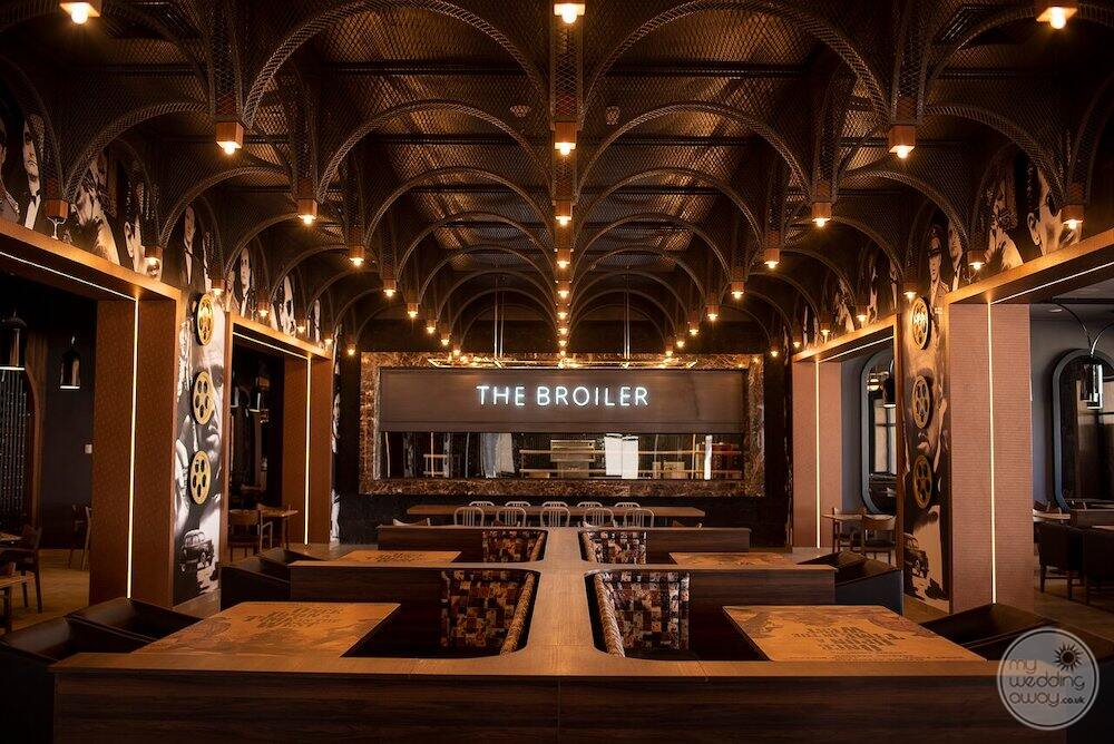 The boiler restaurant with dark wooden chairs and marble tables and high ceilings