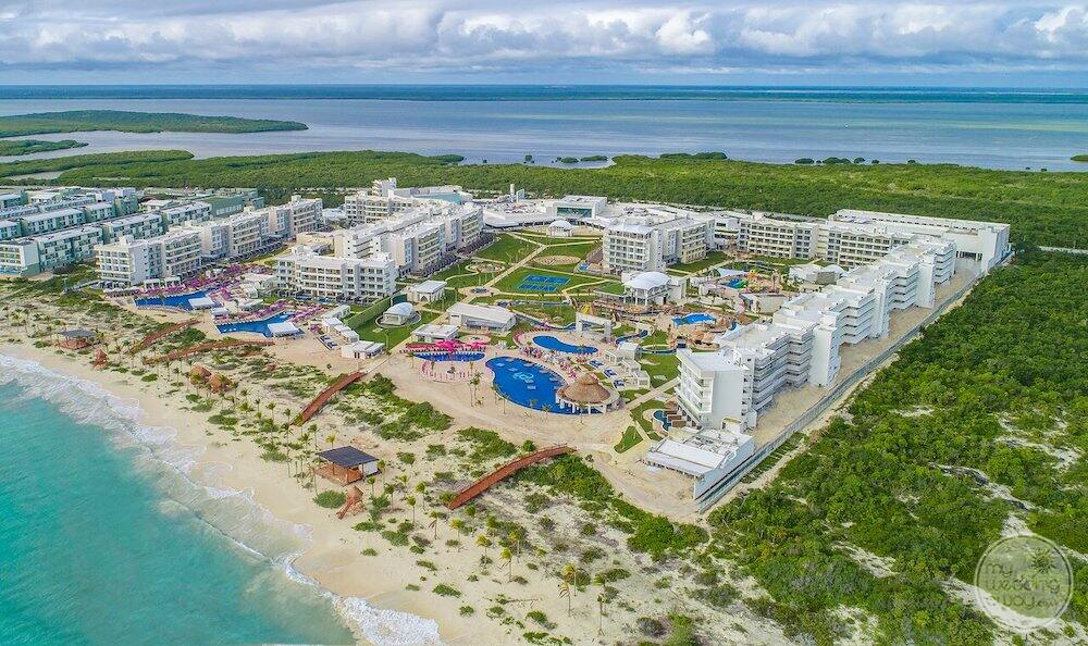 Aerial view of property with caribbean ocean Beach and lagoon in the background
