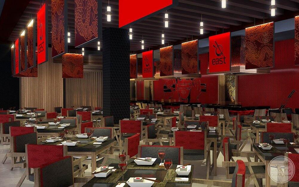 Japanese restaurant with a red Wall feature is red chairs and tables