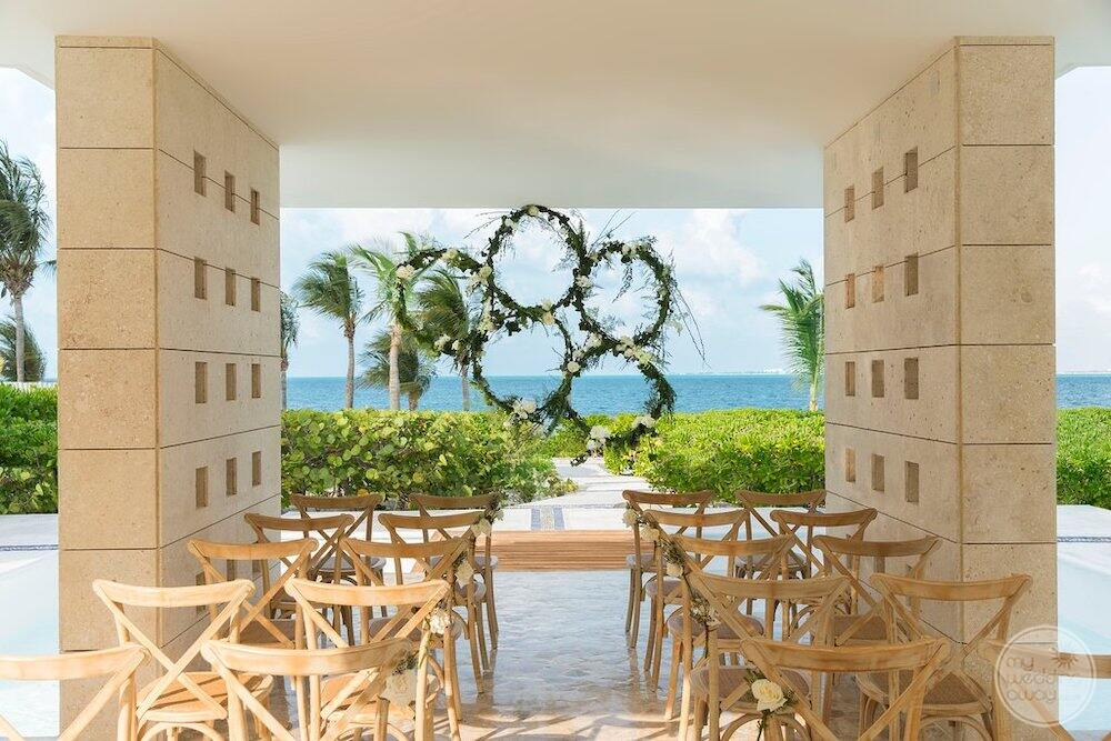 Outdoor ceremony set up for wedding with flower decorations