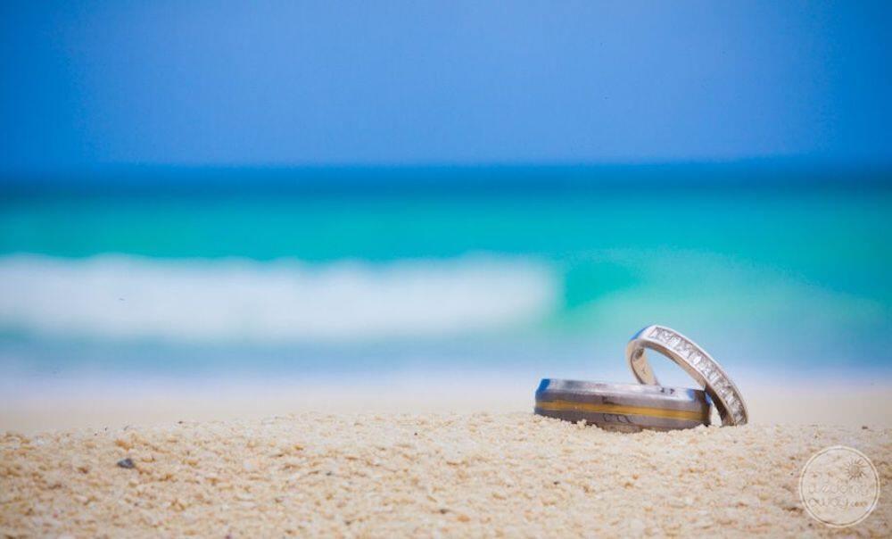 beautiful wedding rings on the beach