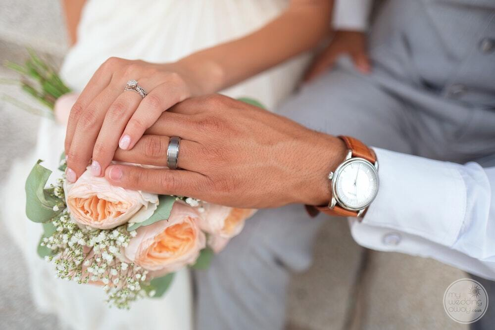 Wedding couples rings together with bridal bouquet